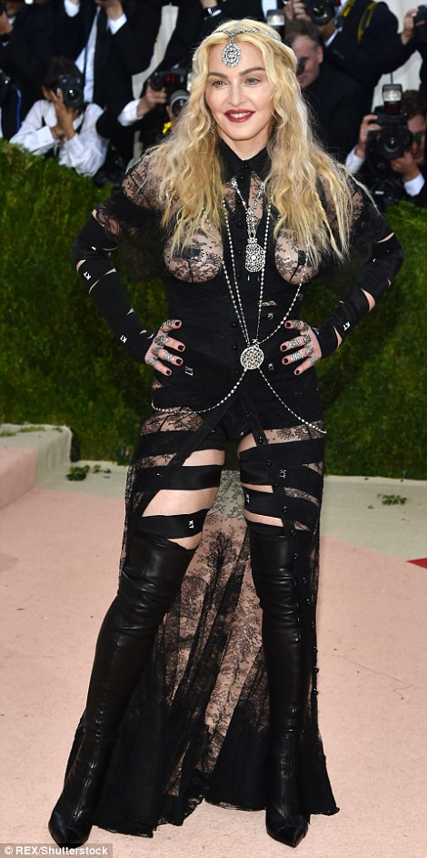 No shame: Madonna, 57, left pretty much nothing to the imagination in this bondage-themed dress with sheer lace panels over the bust and rear