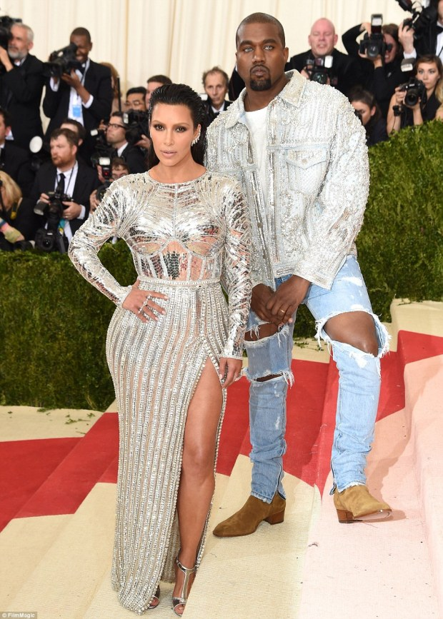 Causing a stir: The 35-year-old star arrived with husband Kanye West who donned ripped jeans and icy blue contact lenses