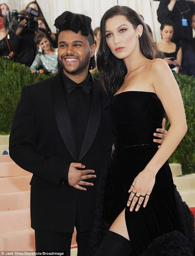 Proud: The Weeknd looked proud as punch as he wrapped an arm around stunning Bella
