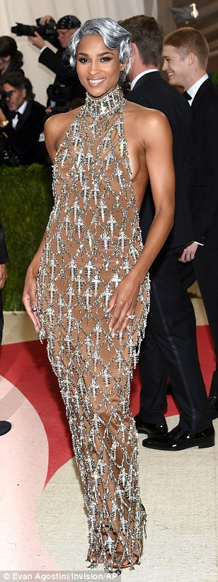 Shimmering star: Songstress Ciara sported a silver wig and dripped in jewels