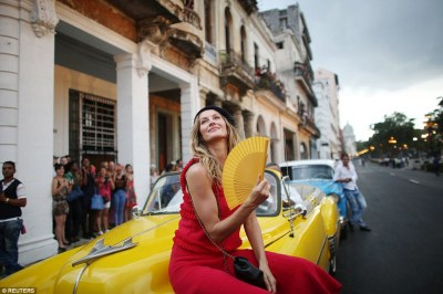 Strike a pose! Fans wait to catch a glimpse of Brazilian top model Gisele Bundchen, who poses before a fashion show by Karl Lagerfeld as part of his latest inter-seasonal Cruise collection for Chanel