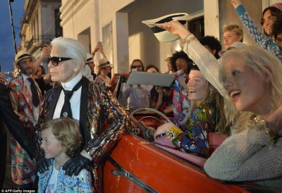 Karl Lagerfeld poses for pictures with his godson Hudson, the son of modelBrad Kroenig who has long collaborated with the designer