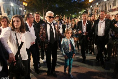 Havana nights: Karl Lagerfeld escorts his godson Hudson at the Paseo del Prado street in Havana, Cuba, after the show