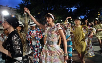 Celebration: Models from the show dance the 'congo' after the show, Chanel's first presentation in Latin America