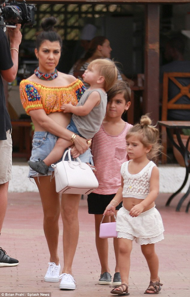 Single mother: The E! cameras were rolling as Kourtney Kardashian and her three children filmed the 13th season while on holiday in Cuba on Wednesday