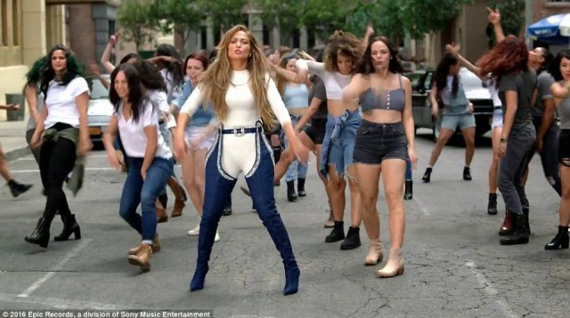 A Thriller type moment: Women dance behind the Boy Next Door star as she busts out some moves Michael Jackson would be proud of