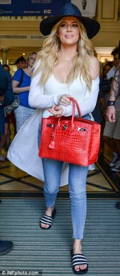 Sister act: Khloe left the hotel shortly afterwards, and like Kourtney she was wearing a white bodysuit