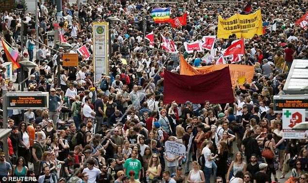 About 1,000 right-wing extremists have rallied outside Berlin's main train station, protesting Chancellor Angela Merkel's welcoming stance to refugees