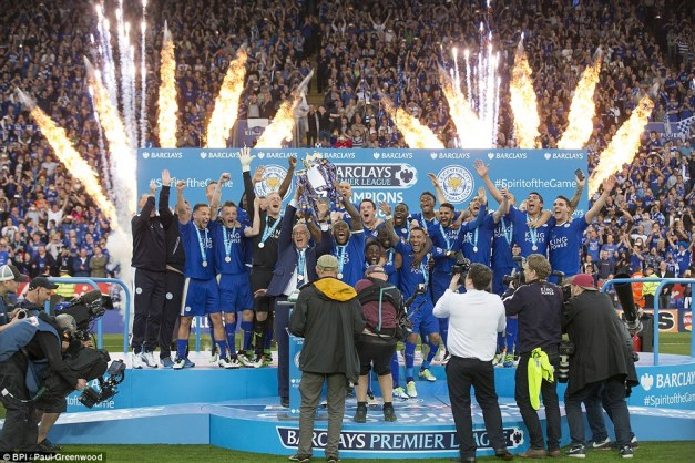 The Leicester City players celebrate winning the 2015-16 Barclays Premier League title by lifting the trophy at the King Power Stadium