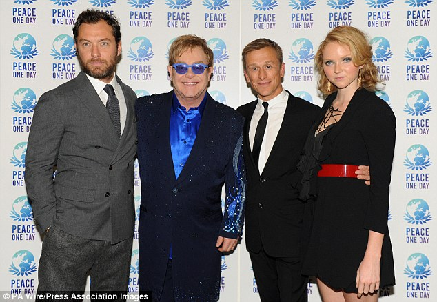 Jeremy Gilley, second right, welcomed celebrities Jude Law, left, Sir Elton John and Lily Cole to a charity concert in aid of his Peace One Day foundation at London's Wembley Arena in 2012