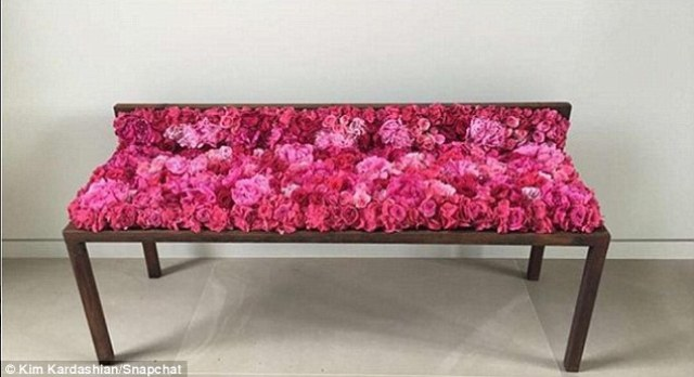 Kanye style: Setting the bar higher than ever, the doting father and husband presented Kim with a bench bedecked in pink flowers, which she shared an image of online