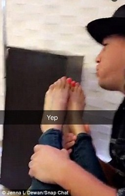 In the next picture, after painting her toenails a baby pink colour, Channing is seen blowing on Jenna's nails to dry them