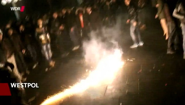 Groups of young men light fireworks into the crowds during the New Year festivities, which police later admitted were out of control