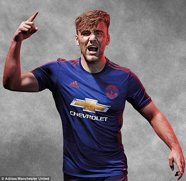 6d550edcb47 United defender Luke Shaw tries the new adidas away kit for size during the  promotional photoshoot