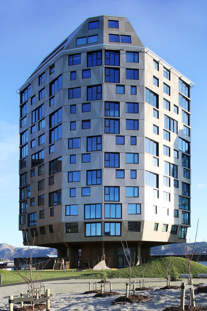 This is one of three residential blocks which make up the Rundeskogen project in Stavanger, Norway. The architect was given an additional problem in his brief - trying to avoid encroaching on an ancient Viking graveyard