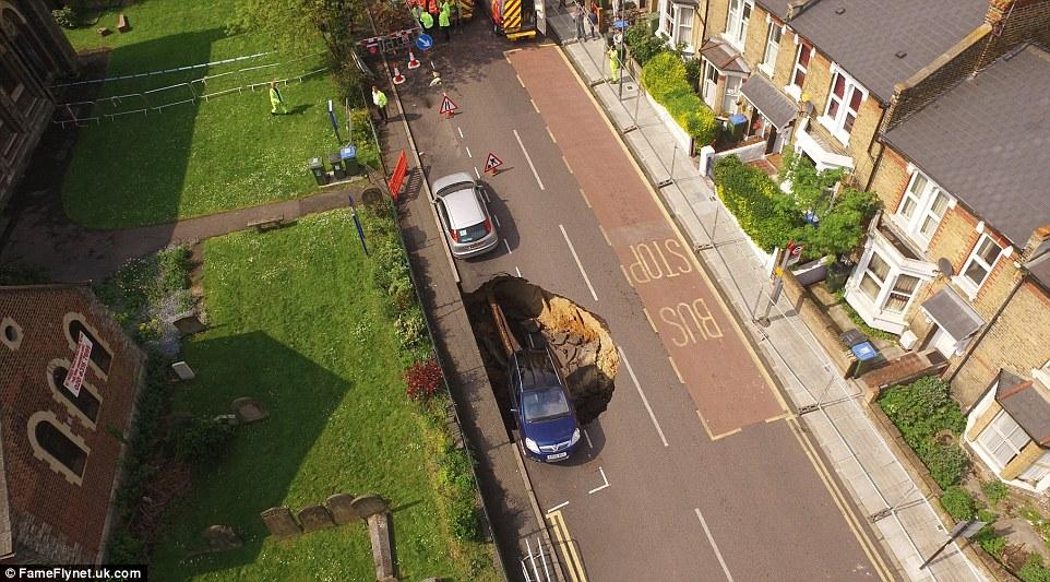 Huge Sinkhole Rips Through Charlton Street In London