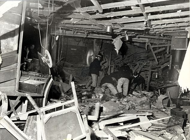 A coroner has revealed today that she has received 'significant' evidence that police had prior knowledge of the Birmingham pub bombings. Pictured are fire officers searching through debris after the blasts in 1974