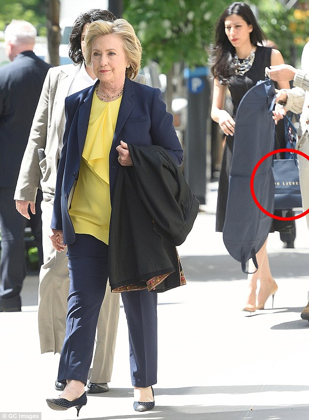 Huma Abedin was left carrying Hillary Clinton's shopping bags on Thursday after her millionaire boss stopped in at Ralph Lauren to pick up some designer clothes