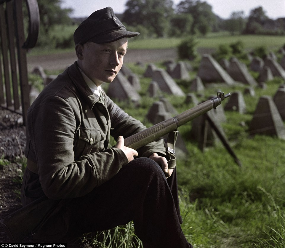 A young guard sits with his weapon along the Siegfried Line in 1947. Originally built in the First World War, Hitler ordered its construction to be renewed after the Allies invaded France. It comprised a series of defensive structures stretching along the German border with the countries to its west