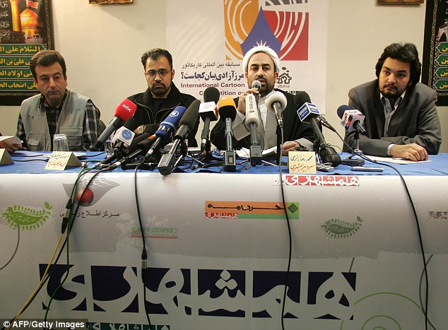 Contest organizer Masuod Shojai Tabatabaei (second from left) said:'Holocaust means mass killing. We are witnessing the biggest killings by the Zionist regime in Gaza and Palestine'