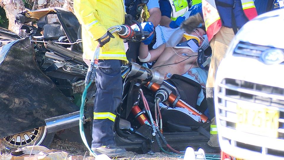 Sydney car crash photos show boy being cut free from the ...