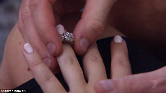 Symbol of their love: Brad took her ring off her finger before putting it back on