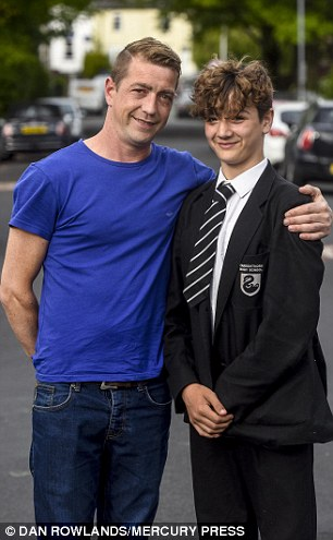 Bradley and his proud dad Kevin who said his teenage son has been 'very coy' about his bold act of bravery
