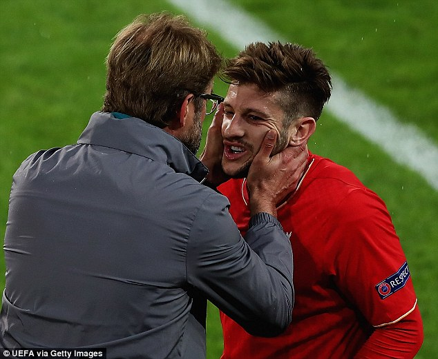 Adam Lallana receives some passionate instructions from Klopp after Sevilla had taken the lead