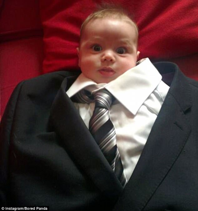 Another dad got so bored that he actually dressed his baby in his adult sized suit, shirt and tie
