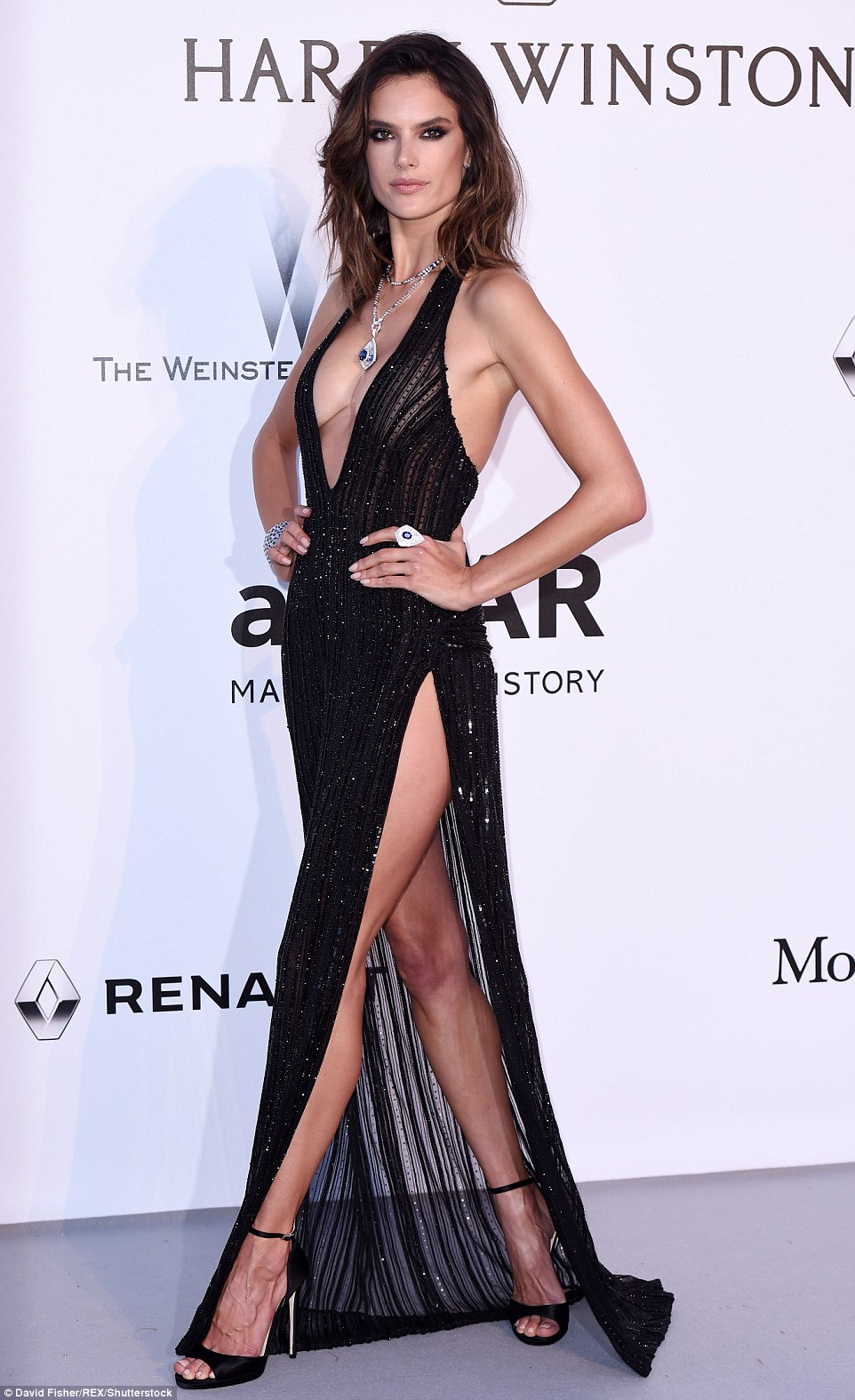 Smoking hot:Alessandra Ambrosio appears to have reached a crescendo with her wildly sexy ensembles as she paraded into Thursday night's amfAR Gala at the Hotel du Cap-Eden-Roc