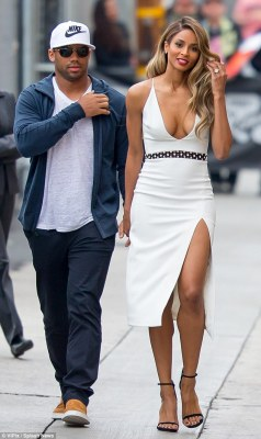 Celebrity couple: The stunning blonde was accompanied by her fiance, Seattle Seahawks quarterback Russell Wilson, 27, who was casually dressed in slacks and a jacket over a t-shirt with a baseball cap
