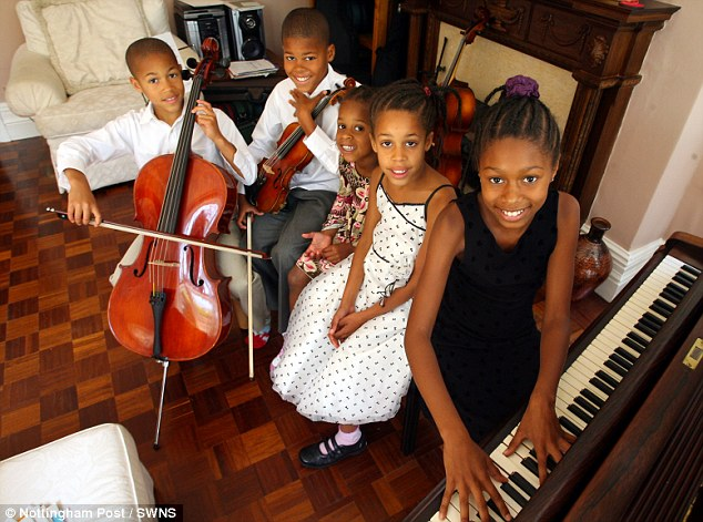 Their home has four pianos, three cellos, a viola, and four violins, and the children practice for two hours a day