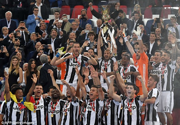 Italian defender Georgio Chiellini lifts the Italian Cup trophy after the 1-0 victory over Milan on Saturday