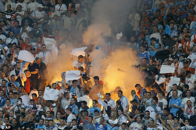 Marseille's fans light a flare during the French Cup final at theStade de France Stadium