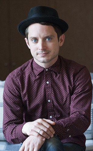 Elijah Wood, 35, (pictured) claims that Hollywood has its own Jimmy Savile scandal and believes young actors are being sexually abused by predatory 'vipers' in the industry