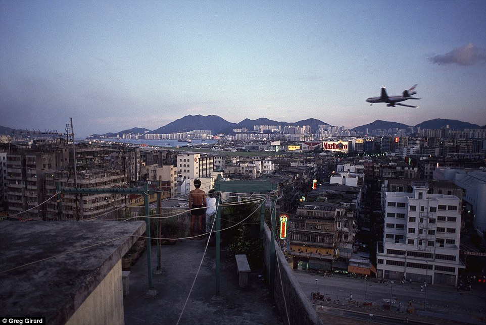 Photographer Greg Girard captured jaw-dropping images of daily life within the six-acre site, including children playing on rooftops