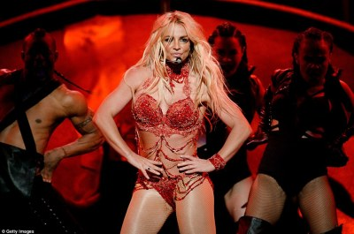 Dared to bare:Throwing off the jacket, the blonde revealed an equally sparkly two piece ensemble that had just tiny panties and red jewel-encrusted bra