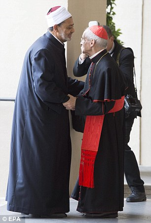 Cardinal Jean-Louis Tauran (centre) embraces el-Tayyib upon his arrival to the Vatican in Rome today