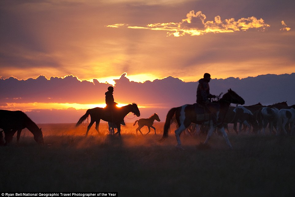 In the Pavlodar region of northeast Kazakhstan, horsemen drive their herd to a corral where they'll spend the night. Kazakhs must guard their animals at all times against horse thieves (a time-honoured tradition in Kazakhstan) and predators like the steppe wolf