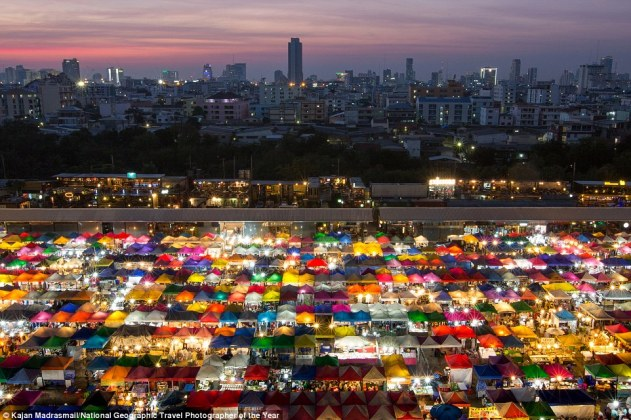 As night falls in Bangkok, Thailand, this colourful market comes alive with colour and light. Kajan Madrasmail snapped the rainbow stalls from above