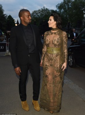 Loved up: Kanye, meanwhile, let his wife take the lead - wearing a simple all-black ensemble as he stared in awe at his stunning partner