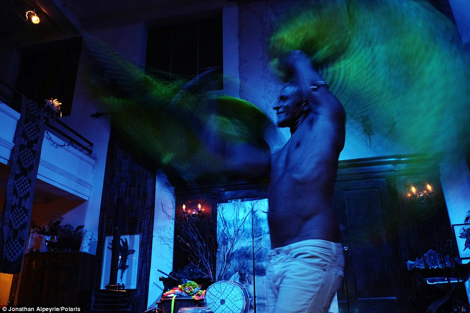 Hot under the collar: During a party in September 2015, Michel performed an exotic dance to his guest under UV lighting