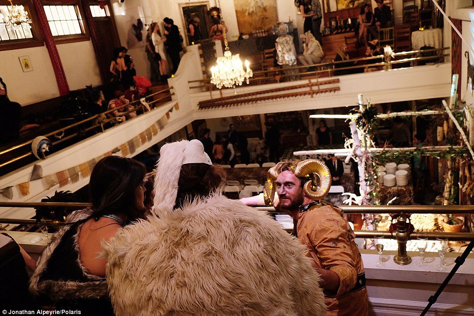 Guests sit in the balcony that once overlooked the church's pulpit for the wedding between Michel and Rasmus