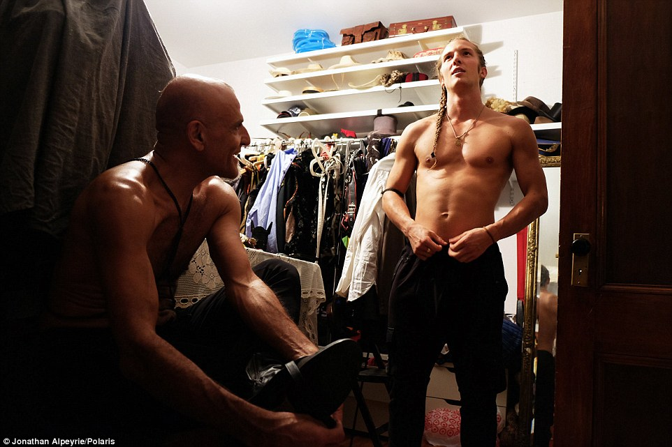Ready for action: Rasmus and Michel are in one of their closets getting ready for a party in September 2015