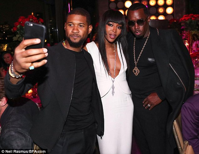 Friendly exes: Usher (left) and Diddy (right) made a Naomi Campbell sandwich on Monday night as her exes helped her celebrate her 46th birthdayat PHD Rooftop Lounge, New York