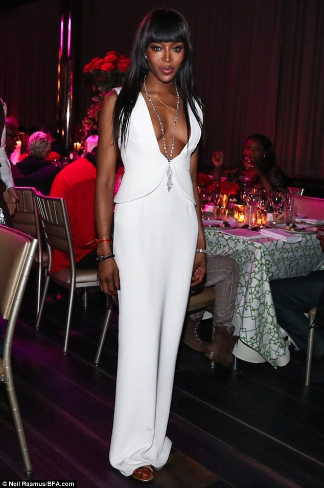 Busty birthday girl: The supermodel looked positively ageless in a plunging dress