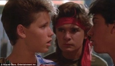 Child stars: Haim (left) and Feldman (center) starred together in films including The Lost Boys (above)