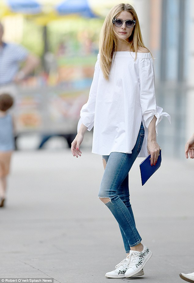 Stylish lady: Olivia Palermo wore an off-the-shoulder white blouse with ripped denim, showing off her toned legs in Brooklyn on Friday