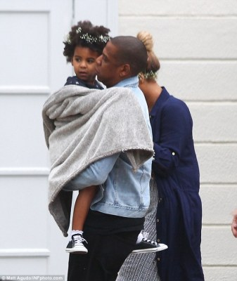 Daddy's girl:For Jay there was no floral adornment, with the 46-year-old record producer and hip hop star dressed in white pumps, black jeans and a denim jacket