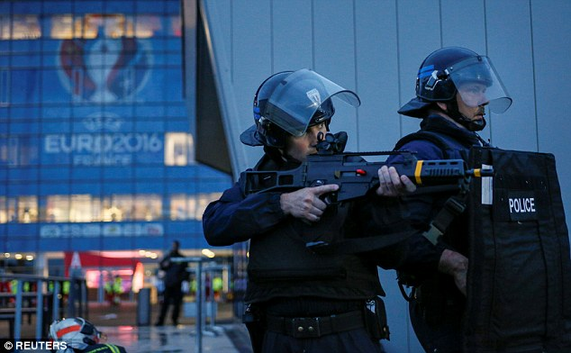 Two anti-terror police officers take part in the dramatic security training drill in France earlier today
